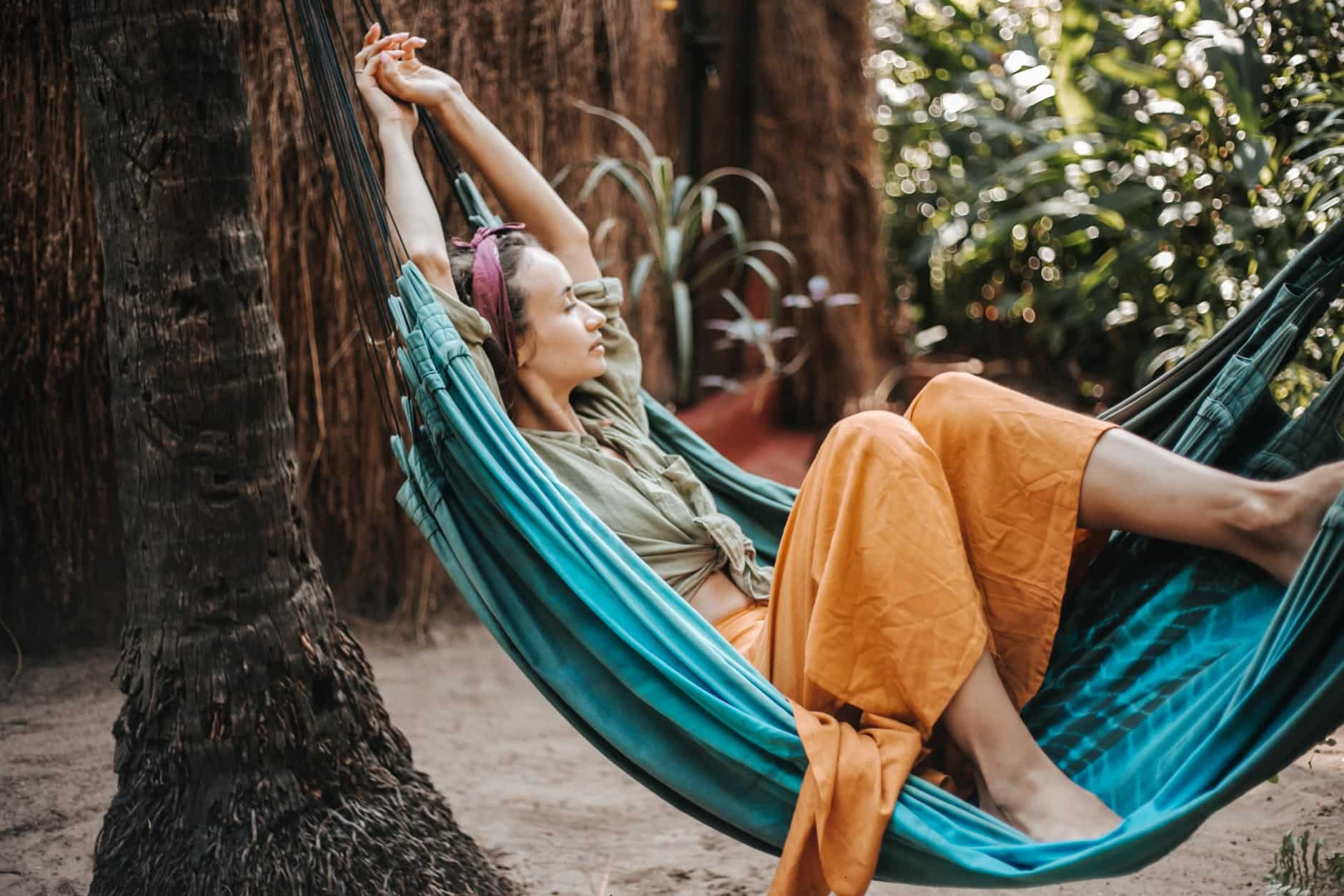 a woman lying on a hammock and resting